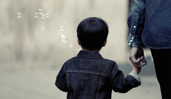 pexels-photo (adult holding hand of child)